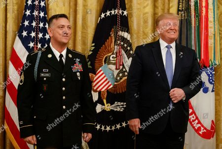 Donald Trump, David Bellavia. President Donald Trump stands with Army Staff Sgt. David Bellavia in the East Room of the White House in Washington, before awarding him the Medal of Honor for conspicuous gallantry while serving in support of Operation Phantom Fury in Fallujah, Iraq