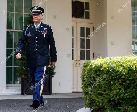 Medal of Honor recipient Army Staff Sgt. David Bellavia walks to speak to media outside the West Wing of the White House in Washington, after receiving the Medal of Honor from President Donald Trump for conspicuous gallantry while serving in support of Operation Phantom Fury in Fallujah, Iraq