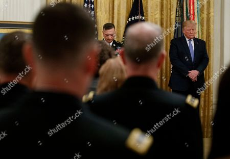 Donald Trump, David Bellavia. President Donald Trump prays during a ceremony to award the Medal of Honor to Army Staff Sgt. David Bellavia in the East Room of the White House in Washington, for conspicuous gallantry while serving in support of Operation Phantom Fury in Fallujah, Iraq