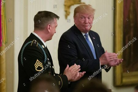 Donald Trump, David Bellavia. President Donald Trump applauds before awarding the Medal of Honor to Army Staff Sgt. David Bellavia in the East Room of the White House in Washington, for conspicuous gallantry while serving in support of Operation Phantom Fury in Fallujah, Iraq