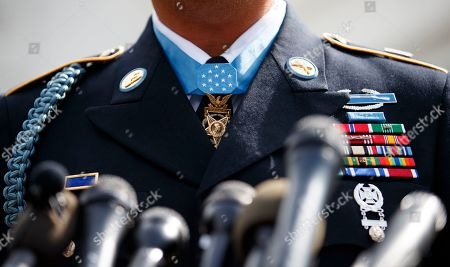 Stock Photo of The Medal of Honor around the neck of Medal of Honor recipient Army Staff Sgt. David Bellavia is seen as he speaks to media outside the West Wing of the White House in Washington, after receiving the Medal of Honor from President Donald Trump for conspicuous gallantry while serving in support of Operation Phantom Fury in Fallujah, Iraq