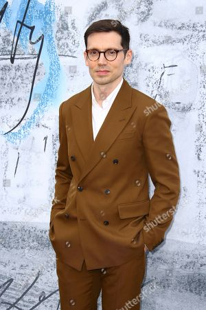 Erdem Moralioglu poses for photographers upon arrival for the Serpentine Gallery Summer Party in London