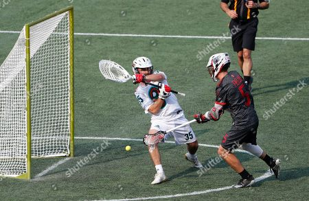 Chaos' Connor Fields scores on Whipsnakes goalie Kyle Bernlohr during a Premiere Lacrosse League game on in Foxborough, Mass