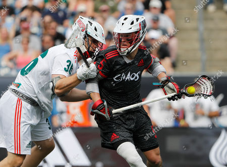 Chaos' Connor Fields controls the ball as Whipsnakes' Tim Muller defends during a Premiere Lacrosse League game on in Foxborough, Mass