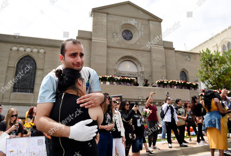 Argin Torosian, Wang Yu Xi. Michael Jackson fans Argin Torosian of Glendale, Calif., top left, and Wang Yu Xi of China embrace outside the late pop star's final resting place in Holly Terrace at Forest Lawn Cemetery, in Glendale, Calif. Tuesday marks the 10th anniversary of Jackson's death