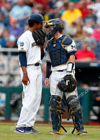 Stock Picture of Michigan pitcher Isaiah Paige, left, talks to catcher Joe Donovan in the third inning of Game 2 against Vanderbilt in the NCAA College World Series baseball finals in Omaha, Neb