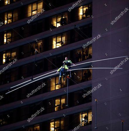 Nik Wallenda, Lijana Wallenda. Aerialists Nik Wallenda, top, prepares to step over his sister, Lijana, bottom, as they walk on a high wire above Times Square, in New York
