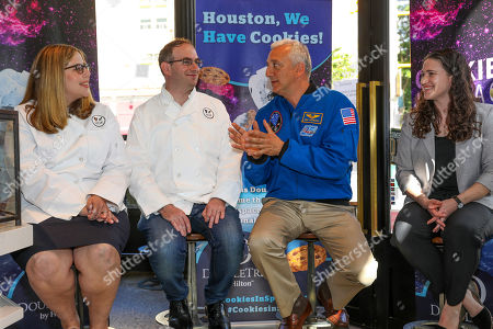 Stock Photo of Zero G Kitchen co-founders Ian and Jordana Fichtenbaum, former NASA astronaut Mike Massimino and Mary Murphy senior internal payloads manager with NanoRacks discuss DoubleTree by Hilton Cookie is the first cookie to be baked in space