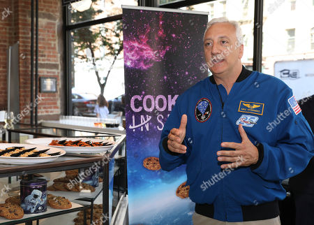 """Stock Picture of At the DoubleTree by Hilton """"Cookies in Space"""" event on in New York, guests heard from former NASA astronaut Mike Massimino about the importance of continuously improving the food options for astronauts and the future of space travel"""
