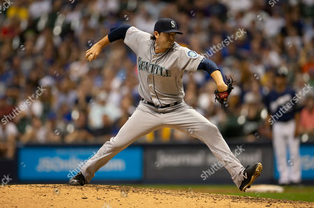 Stock Photo of Seattle Mariners relief pitcher Cory Gearrin #35 delivers a pitch during the Major League Baseball game between the Milwaukee Brewers and the Seattle Mariners at Miller Park in Milwaukee, WI