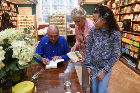 Ken Livingstone signs a copy of his new book during the Livingstone's London Book Launch at Daunt Books on 25th June 2019