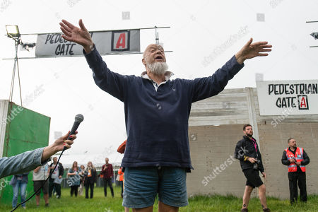 Michael Eavis opens the gates of the festival for the first time, after giving a short speech to those at the front of the queue