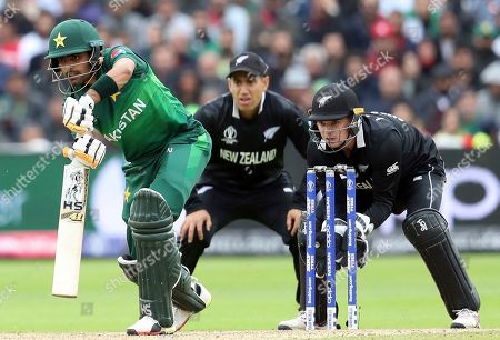 Pakistan's batsman Babar Azam, left, watches his shot New Zealand's Ross Taylor, middle, with wicketkeeper Tom Latham looks on during the Cricket World Cup match between New Zealand and Pakistan at the Edgbaston Stadium in Birmingham, England