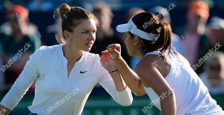 Simona Halep & Raluca Olaru of Romania playing doubles