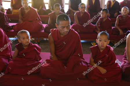Stock Picture of Buddhist monks take part in a prayer session as they celebrate the 34th birth anniversary of 17th Gyalwa Karmapa, Ogyen Trinley Dorje (not pictured), in Gyuto Monastery near Dharamsala, India, 26 June 2019. Gyalwa Karmapa, Ogyen Trinley Dorje is the third most important Tibetan religious head.