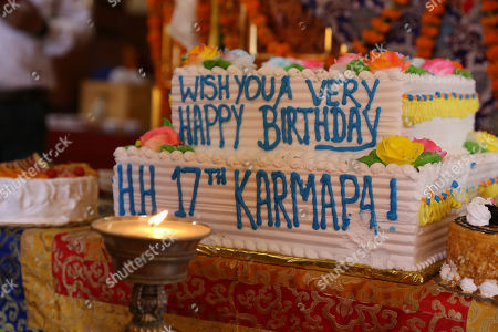 Stock Photo of A birthday cake is placed as Buddhist monks (unseen), take part in an event to celebrate the 34th birth anniversary of 17th Gyalwa Karmapa, Ogyen Trinley Dorje (not pictured), in Gyuto Monastery near Dharamsala, India, 26 June 2019. Gyalwa Karmapa, Ogyen Trinley Dorje is the third most important Tibetan religious head.