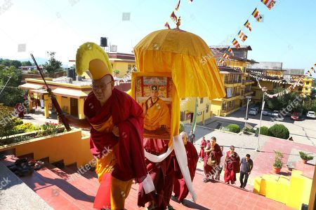 Stock Image of Buddhist monks carry a portrait of 17th Gyalwa Karmapa, Ogyen Trinley Dorje as they take part in celebration of his 34th birth anniversary, in Gyuto Monastery near Dharamsala, India, 26 June 2019. Gyalwa Karmapa, Ogyen Trinley Dorje is the third most important Tibetan religious head.