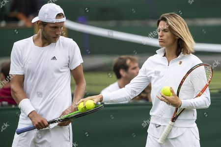 Lucas Pouille of France (L) talks to his coach Amelie Mauresmo during a training session at the All England Lawn Tennis Championships in Wimbledon, London, Britain, 26 June 2019. The Wimbledon Tennis Championships 2019 will be held in London from 01 July to 14 July 2019.