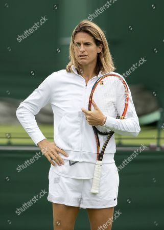 Stock Image of Amelie Mauresmo, former French tennis player and coach of French player Lucas Pouille, watches a training session at the All England Lawn Tennis Championships in Wimbledon, London, Britain, 26 June 2019. The Wimbledon Tennis Championships 2019 will be held in London from 01 July to 14 July 2019.