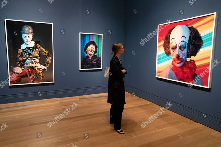 A member of the media looks at photographs during a press preview of an exhibition of the work of American photographer and artist Cindy Sherman and the National Portrait Gallery in Central London, Britain, 26 June 2019. The exhibition will run from 27 June until 15 September 2019.