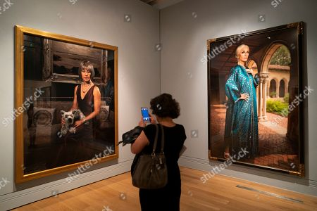 Stock Photo of A member of the media takes a photograph during a press preview of an exhibition of the work of American photographer and artist Cindy Sherman and the National Portrait Gallery in Central London, Britain, 26 June 2019. The exhibition will run from 27 June until 15 September 2019.