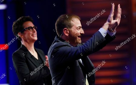 Chuck Todd, NBC News Political Director, and Rachel Maddow, MSNBC host, call for a pause during a Democratic primary debate hosted by NBC News at the Adrienne Arsht Center for the Performing Art, in Miami