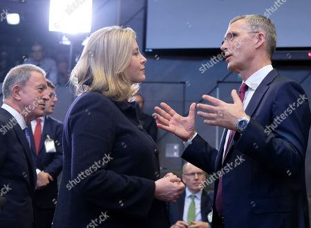 British Defense secretary Penny Mordaunt (L) and NATO Secretary General Jens Stoltenberg at the start of a North Atlantic council meeting during NATO defense ministers meeting in Brussels, Belgium, 26 June 2019. NATO Defense ministers gather in Brussels on 26-27 June 2019.