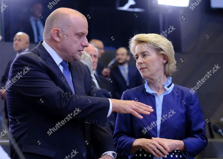 Stock Photo of Estonian Defense minister Juri Luik and German Defense Minister Ursula von der Leyen (R) at the start of a North Atlantic council meeting during NATO defense ministers meeting in Brussels, Belgium, 26 June 2019. NATO Defense ministers gather in Brussels on 26-27 June 2019.