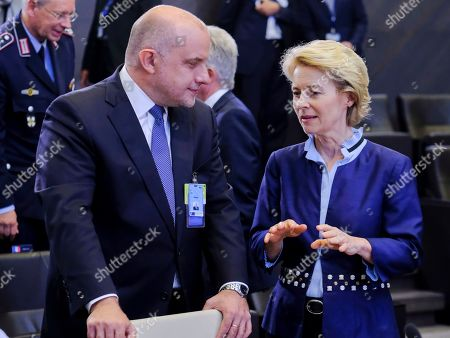 Stock Picture of Estonian Defense minister Juri Luik and German Defense Minister Ursula von der Leyen (R) at the start of a North Atlantic council meeting during NATO defense ministers meeting in Brussels, Belgium, 26 June 2019. NATO Defense ministers gather in Brussels on 26-27 June 2019.