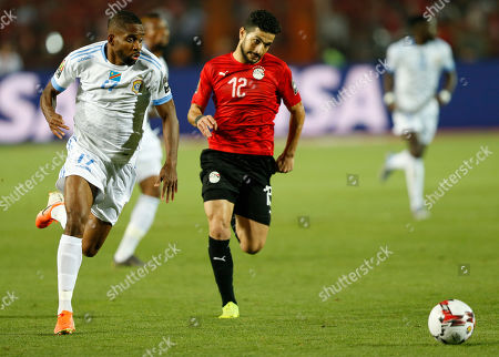 DR Congo's Cedric Bakambu in action in front of Egypt's Ayman Ashraf during the group A soccer match between Egypt and DR Congo at the Africa Cup of Nations at Cairo International Stadium in Cairo, Egypt
