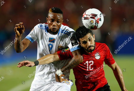 Congo's Jonathan Bolingi Mpang, left, and Egypt's Ayman Ashraf fight for the ball during the group A soccer match between Egypt and DR Congo at the Africa Cup of Nations at Cairo International Stadium in Cairo, Egypt