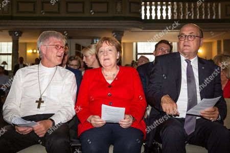 (L-R) Regional Bishop and Council Chairman of the Evangelical Church in Germany (EKD) Heinrich Bedford-Strohm, German Chancellor Angela Merkel, Plenipotentiary of the Council of the EKD Prelate Martin Dutzmann, Attend the traditional Johannisempfang event at the French Friedrichstadtkirche Church in Berlin, Germany, 26 June, 2019. Politicians, culture figures and other guests gathered in the event organized by the Evangelical Church in Germany (EKD).