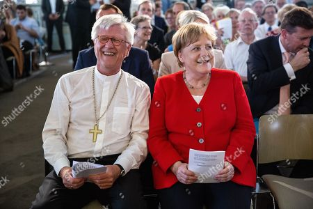 German Chancellor Angela Merkel (R), Regional Bishop and Council Chairman of the Evangelical Church in Germany (EKD) Heinrich Bedford-Strohm (L) attend the traditional Johannisempfang event at the French Friedrichstadtkirche Church in Berlin, Germany, 26 June, 2019. Politicians, culture figures and other guests gathered in the event organized by the Evangelical Church in Germany (EKD).