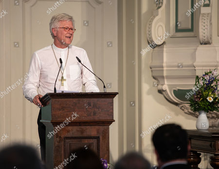 Stock Image of Regional Bishop and Council Chairman of the Evangelical Church in Germany (EKD) Heinrich Bedford-Strohm, delivers a speech at the traditional Johannisempfang event at the French Friedrichstadtkirche Church in Berlin, Germany, 26 June, 2019. Politicians, culture figures and other guests gathered in the event organized by the Evangelical Church in Germany (EKD).