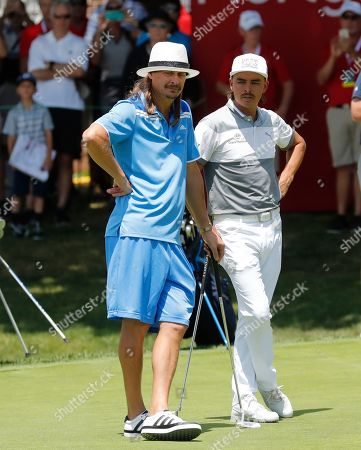 Rickie Fowler, Kid Rock. Kid Rock, left, and Rickie Fowler stand on the 18th green during Pro-Am at the Rocket Mortgage Classic golf tournament, in Detroit