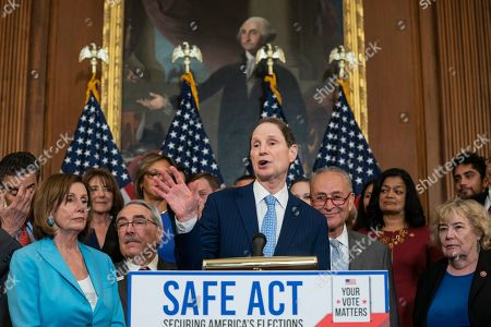 Democratic Senator from Oregon Ron Wyden (C), along side Democratic Speaker of the House from California Nancy Pelosi (L) and Democratic Senate Minority Leader from New York Chuck Schumer (R), speaks to the media about the SAFE Act in the US Capitol in Washington, DC, USA, 26 June 2019. The bill is aimed at safeguarding US elections from cybersecurity threats.