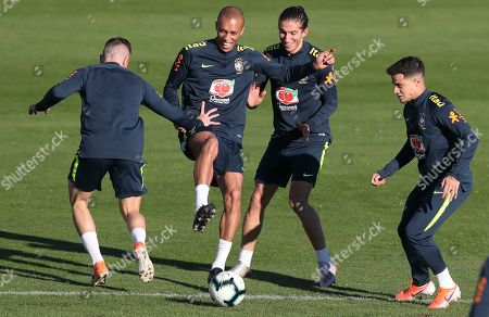 Arthur, Miranda, Filipe Luis and Phlippe Coutinho, from left to right, play with a ball during a training session of Brazil national soccer team in Porto Alegre, Brazil, . Brazil will play against Paraguay for a Copa America quarter-final match on June 27
