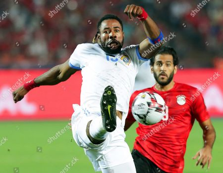 Egypt's Marwan Mohsen (R) in action against DR Congo's Christian Luyindama (L) during the 2019 Africa Cup of Nations (AFCON) group A soccer between Egypt and DR Congo in Cairo, Egypt, 26 June 2019.