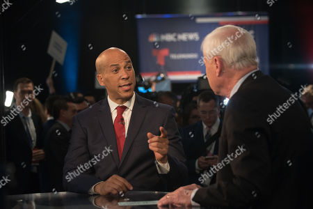 Senator Cory Booker speaks with Chris Matthews in the Spin Room after the First Democratic Debate in Miami at the Adrienne Arsht Center