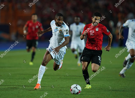 Yousuf Mulumbu of Rd Congo in front of Ayman Ashraf Elsayed of Egypt during the African Cup of Nations match between Egypt and DR Congo at the Cairo International Stadium in Cairo, Egypt
