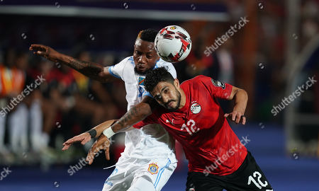 Jonathan Bolingi Mpangi of Rd Congo and Ayman Ashraf Elsayed of Egypt challenging for the ball during the African Cup of Nations match between Egypt and DR Congo at the Cairo International Stadium in Cairo, Egypt