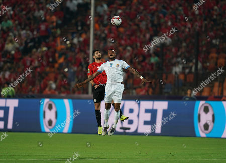 Ayman Ashraf Elsayed of Egypt and Jonathan Bolingi Mpangi of Rd Congo challenging for the ball during the African Cup of Nations match between Egypt and DR Congo at the Cairo International Stadium in Cairo, Egypt