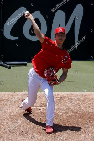 Los Angeles Angels' Shohei Ohtani throws in the bullpen before a baseball game against the Cincinnati Reds in Anaheim, Calif., . Ohtani threw off a mound for the first time since Tommy John surgery Oct 1, 2018