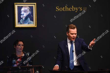 Oliver Barker, Chairman, Sotheby's Europe, fields bids for Self-Portrait by Francis Bacon, Est. £15,000,000 - 20,000,000 which sold for a hammer price of £14,350,000
