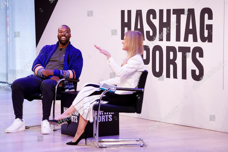 Stock Photo of Baron Davis from Baron Davis Enterprises, being interviewed on staged by Bonnie Bernstein, at the Hashtag Sports event, at The Times Center on in New York