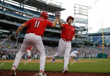 Anthony Gonzalez, Barry Loudermilk. Rep. Anthony Gonzalez, R-Ohio, right, celebrates with teammate Rep. Barry Loudermilk, R-Ga., after scoring in the first inning of the Congressional Baseball Game at National's Park in Washington, . The Democrats won 14-7