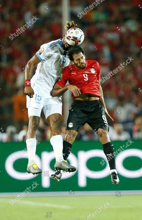 DR Congo's Christian Luyidama Nekadio, left, goes for the ball with Egypt's Marwan Mohsen during the group A soccer match between Egypt and DR Congo at the Africa Cup of Nations at Cairo International Stadium in Cairo, Egypt