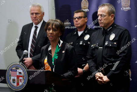 Los Angeles County District Attorney Jackie Lacey, second from left, addresses the media regarding the arrest of Dr. George Tyndall, in Los Angeles. Tyndall was charged today with sexually assaulting multiple women at the student health center while he worked as a gynecologist at the University of Southern California, the Los Angeles County District Attorney's Office announced