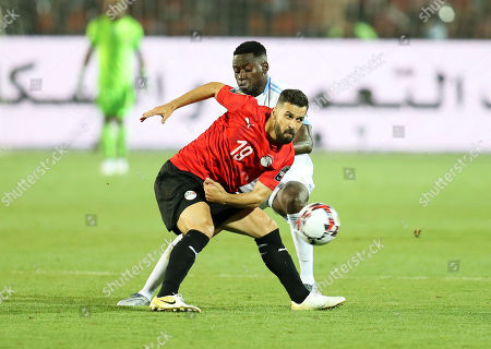 Abdallah El Said (L) of Egypt in action against Wilfred Moke (R) of DR Congo during the 2019 Africa Cup of Nations (AFCON) group A soccer between Egypt and DR Congo in Cairo, Egypt, 26 June 2019.