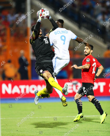 Egypt's goalkeeper Mohamed El Shenawy (L) in action against Jonathan Bolingi (C) of DR Congo during the 2019 Africa Cup of Nations (AFCON) group A soccer between Egypt and DR Congo in Cairo, Egypt, 26 June 2019.